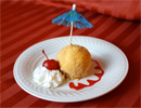 plated fried ice cream with umbrella